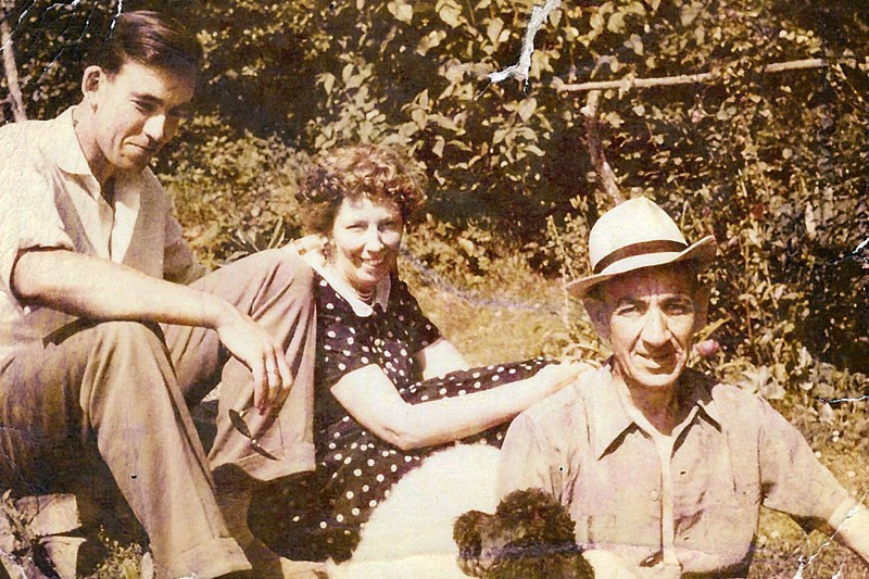 Jeremy Shirley at home in the garden with parents Eric and Eve. 1956